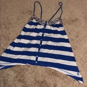 Striped and floral tank top. Cotton material.